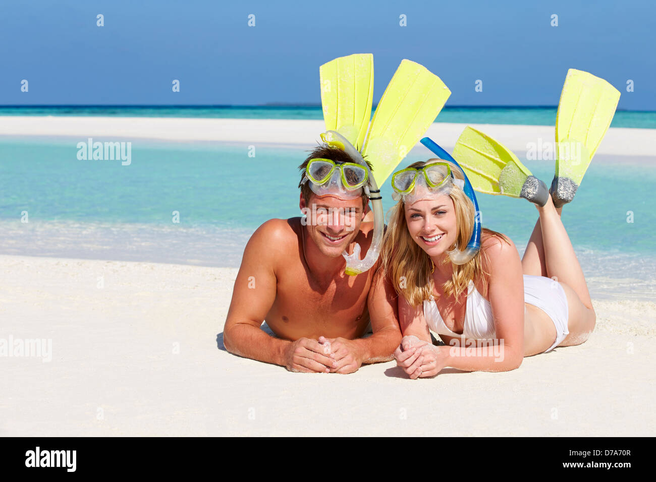Couple With Snorkels Enjoying Beach Holiday - Stock Image
