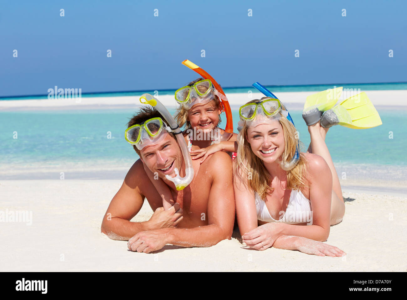 Family With Snorkels Enjoying Beach Holiday - Stock Image