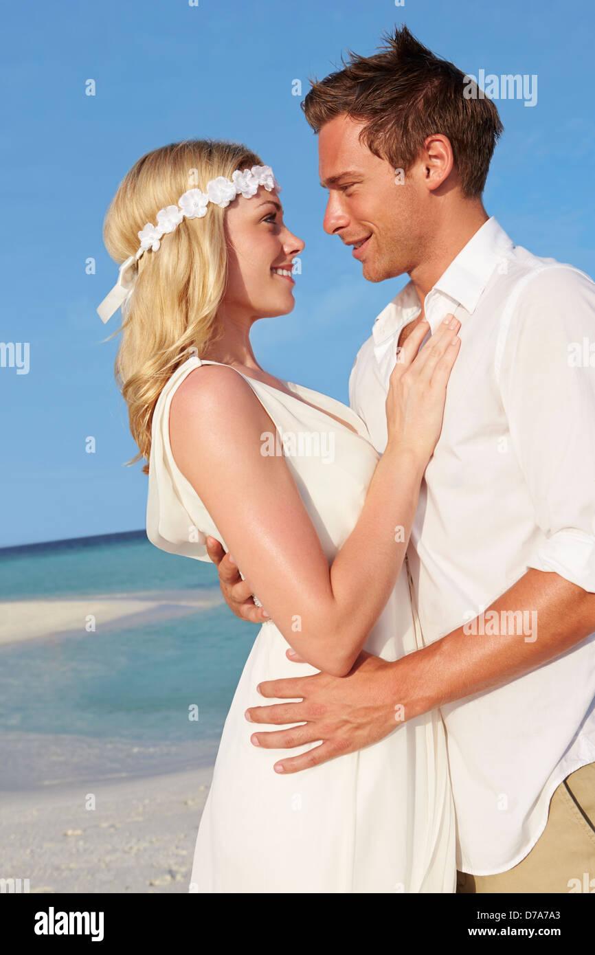 Couple At Beautiful Beach Wedding - Stock Image