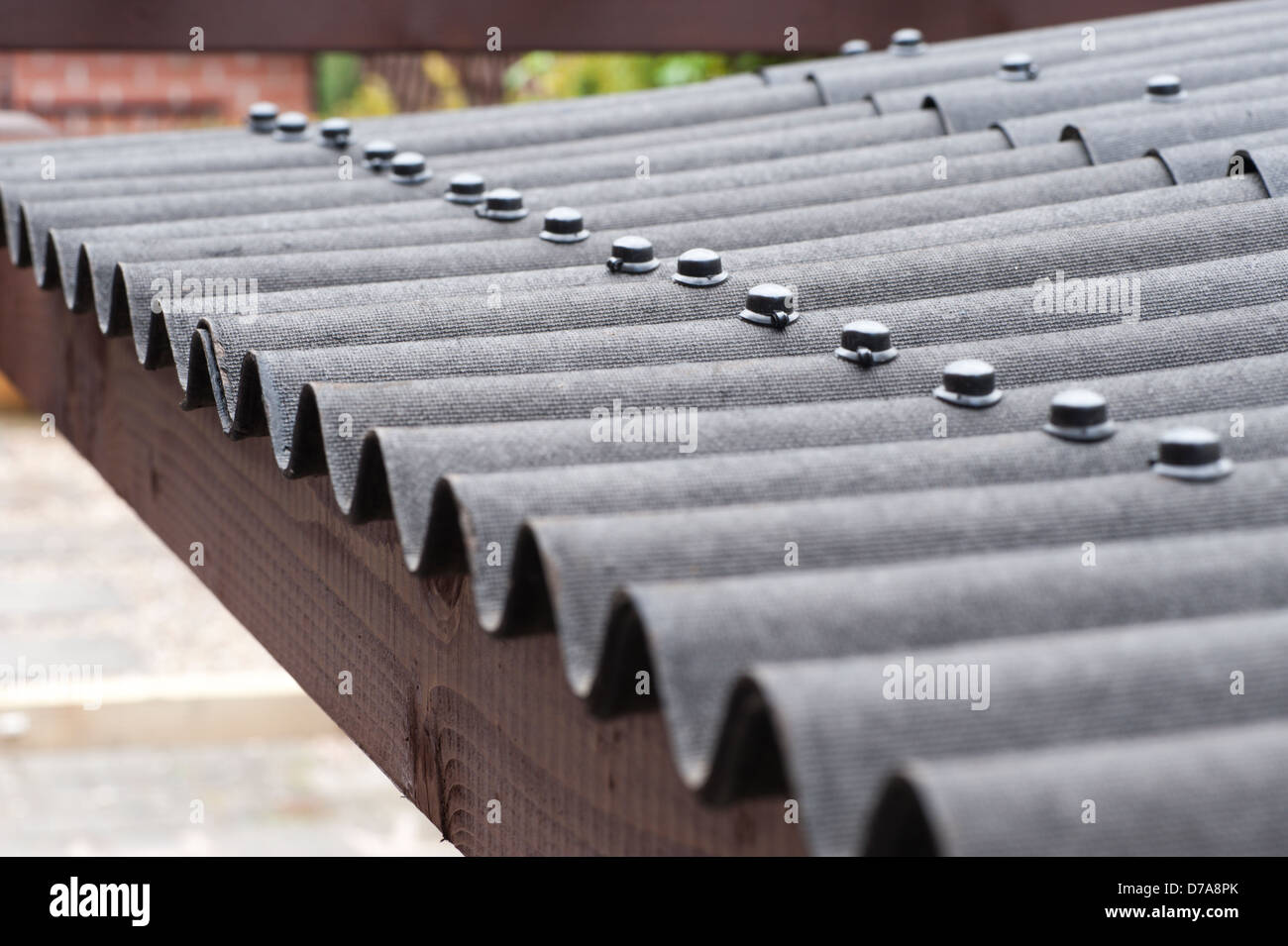 Nail fixed black bitumen corrugated roofing with no gutter Stock