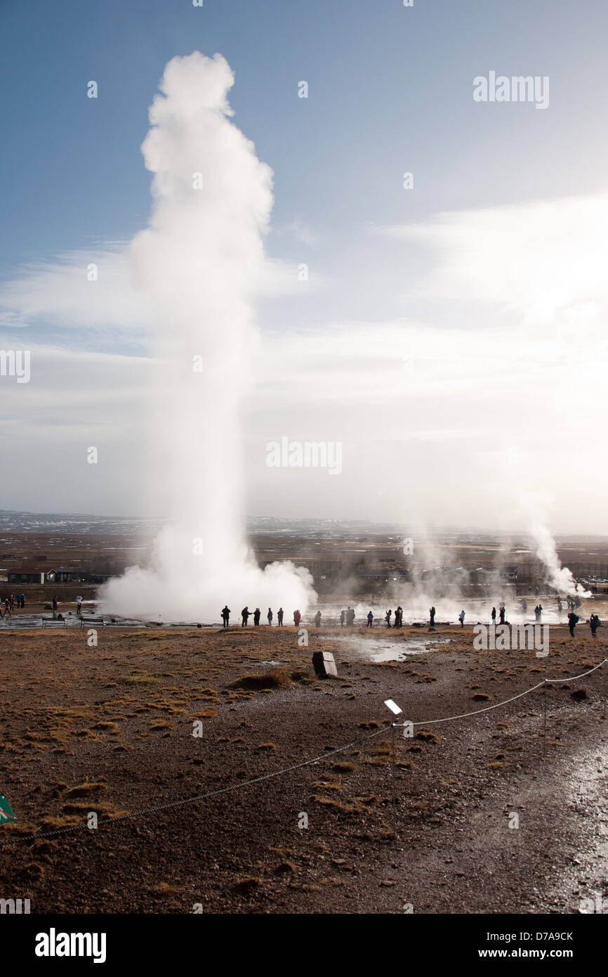Famous geyser Strokkur erupts, sending a tower of steam high into the air, Iceland. - Stock Image