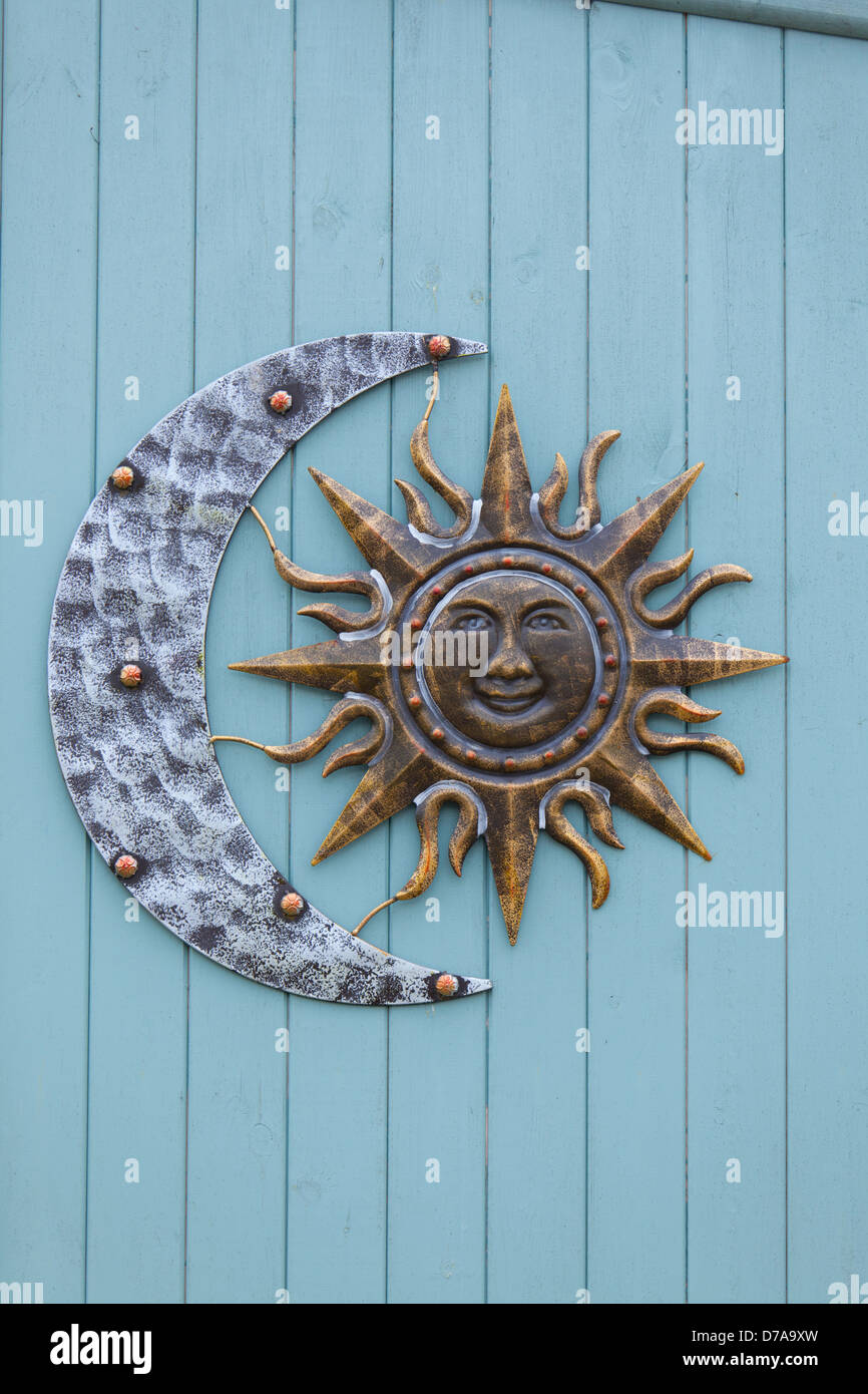 Sun And Crescent Moon Decorative Garden Wall Art On Blue Timber