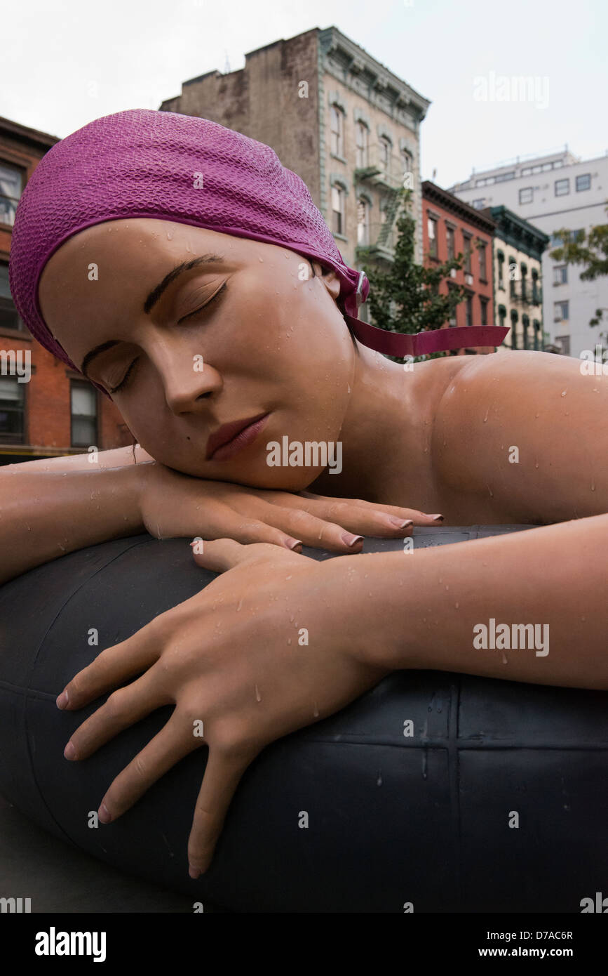 Survival of Serena is a piece of art by Carole Feuerman located in Petrosino Square in New York. - Stock Image