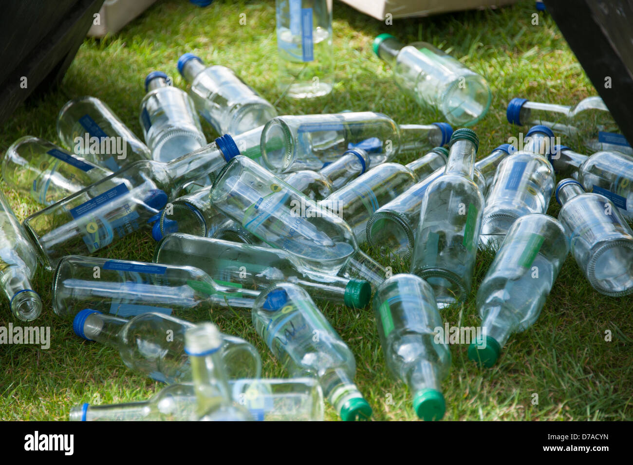 Empty Water bottles Mineral on grass pile dropped - Stock Image