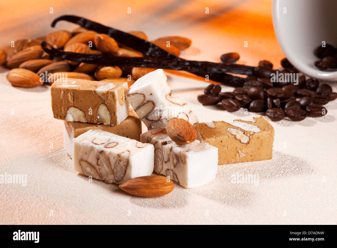 Fine nougat from Belgium flavored with coffee and vanilla surrounded with its ingredients - Stock Image