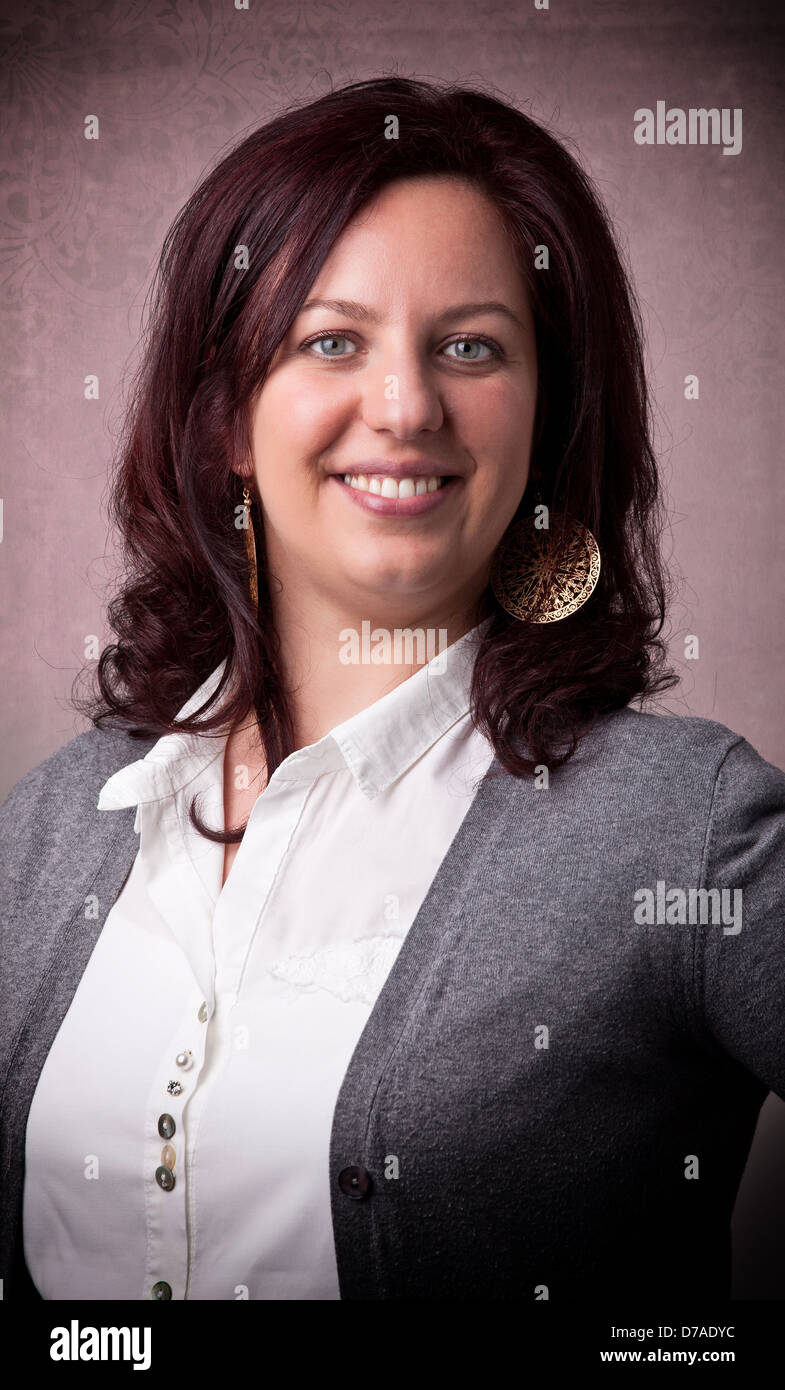 portrait of caucasian woman with red hair - Stock Image