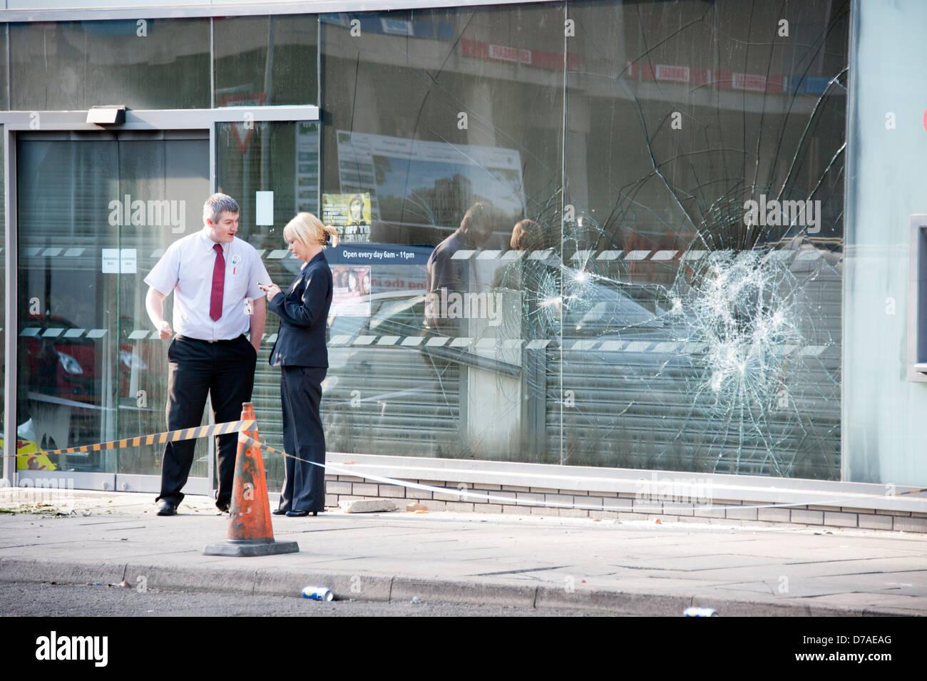Smashed shop Tesco Window riot Rioting Theft crime - Stock Image