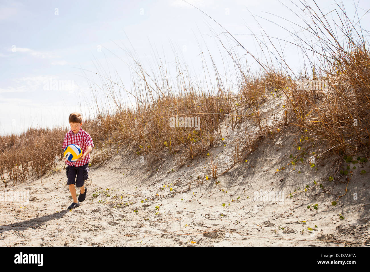 boy kicking a soccer ball - Stock Image
