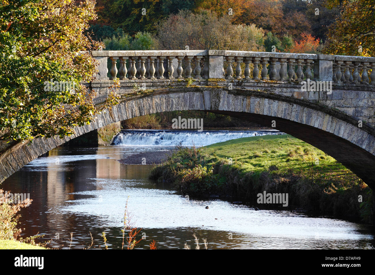 A stone bridge over the White Cart Water in Pollok Country Park in Glasgow, Scotland, UK - Stock Image