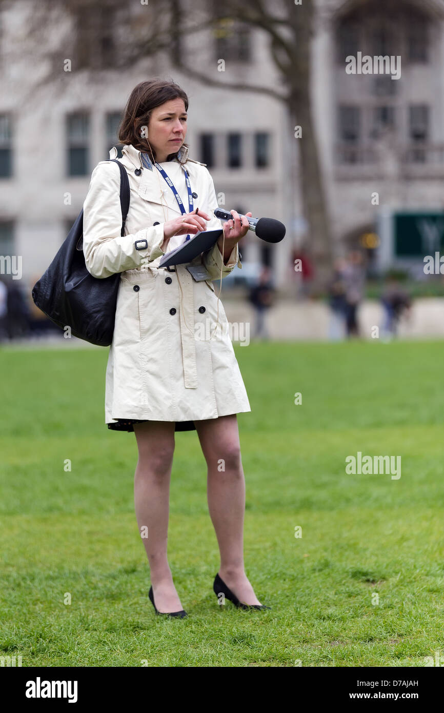 London, UK. 26th April 2013. Woman reporter writing and recording the march of the beekeepers for the bees protection. - Stock Image