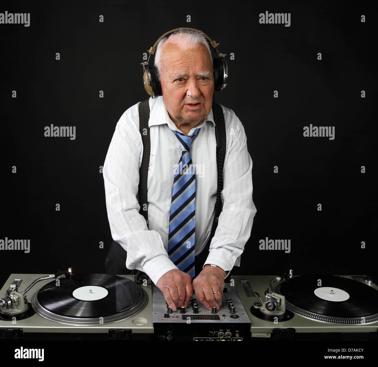 a very funky elderly grandpa dj mixing records Stock Photo