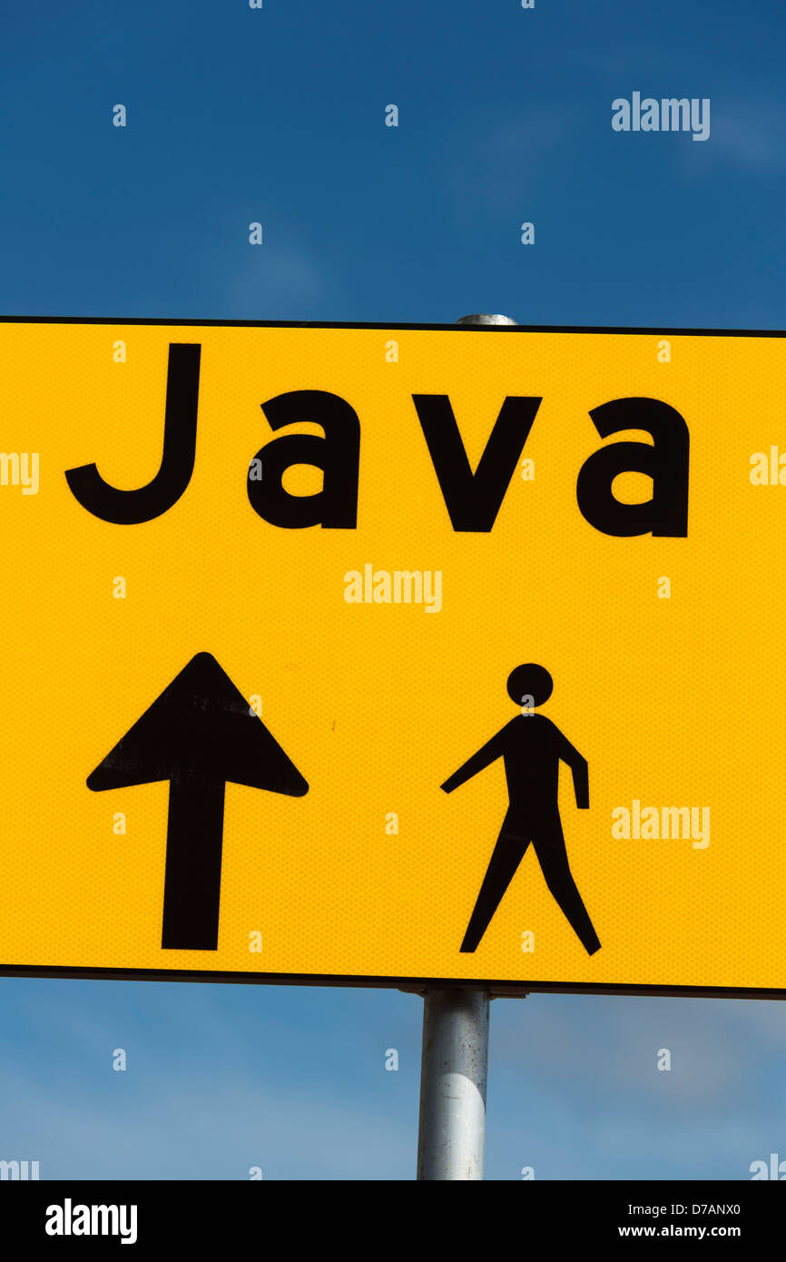 Yellow signpost for a footpath to Java Island or Java Eiland in Amsterdam against a blue sky - Stock Image