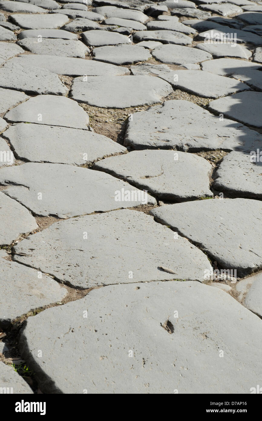 ancient roman road made of flagstones in the roman forum rome italy Stock Photo
