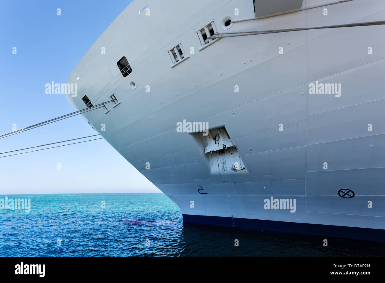 ship bow moored below horizon - Stock Image