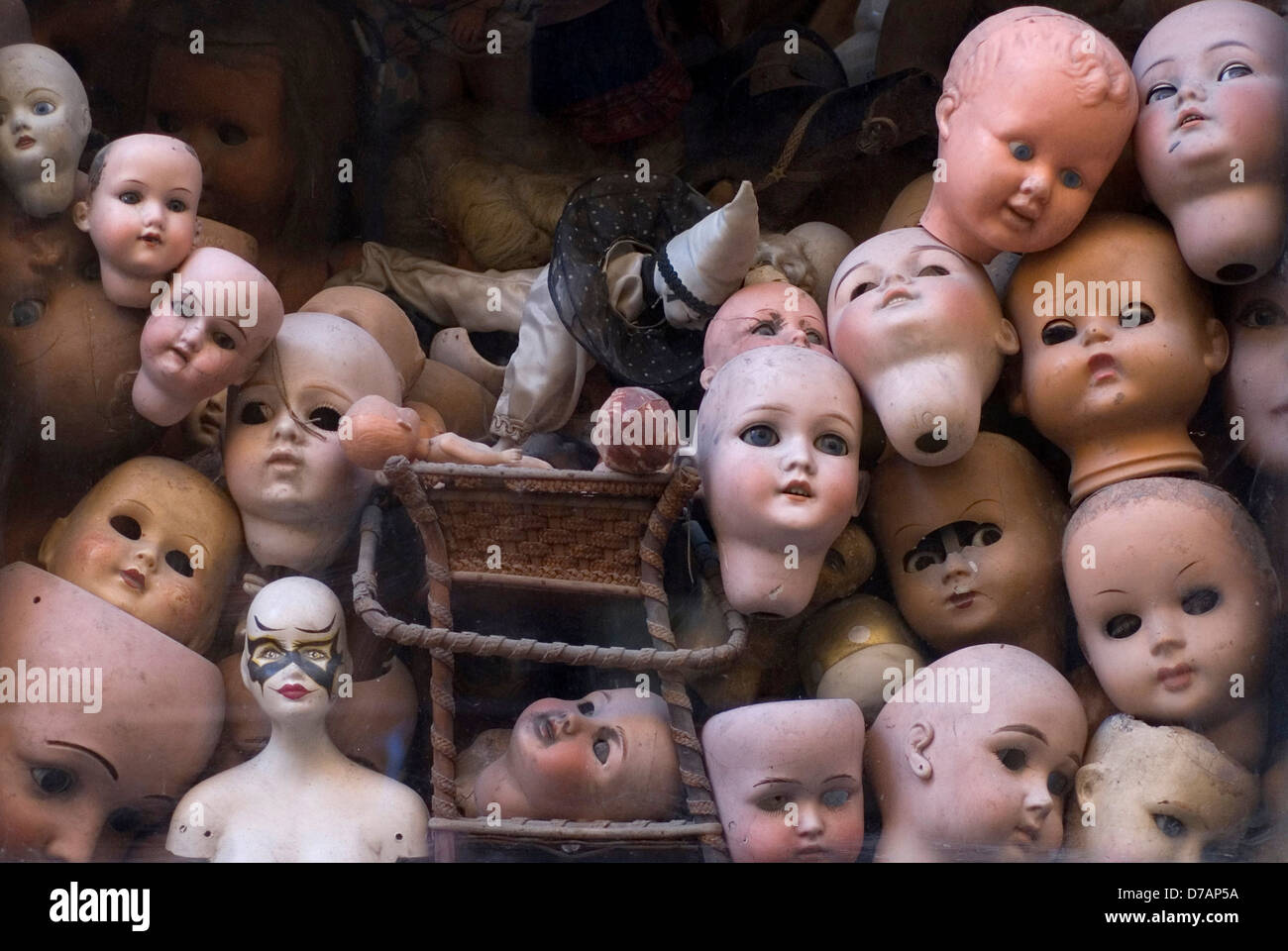 macabre display of old dolls heads Stock Photo