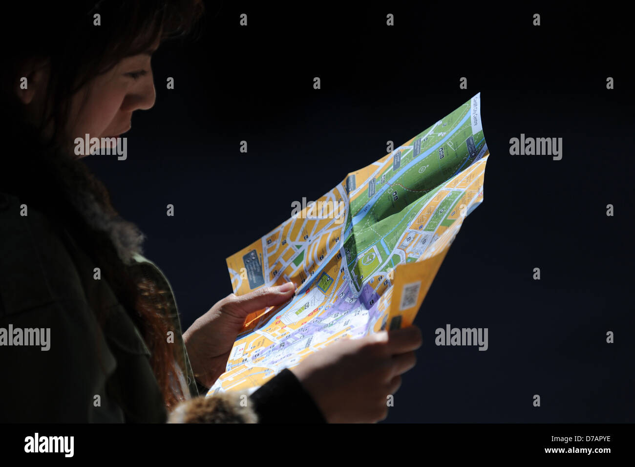 A tourist looks at a map of Cardiff. - Stock Image