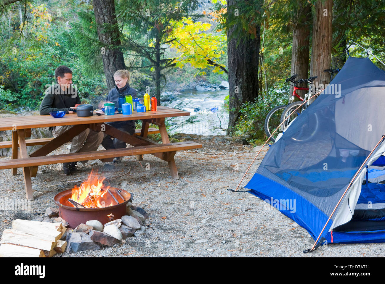 couple at campsite in the campground at the sooke potholes. Black Bedroom Furniture Sets. Home Design Ideas