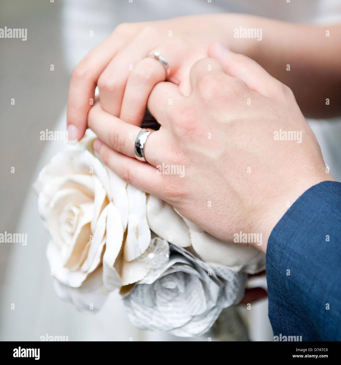 Wedding Rings Flowers Hands Stock Photos & Wedding Rings Flowers ...