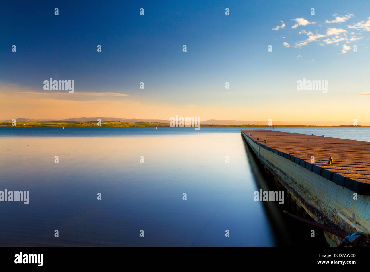 Sunset by dock near Deer Flat Upper Dam on shores of Lake Lowell outside Nampa, Idaho - Stock Image