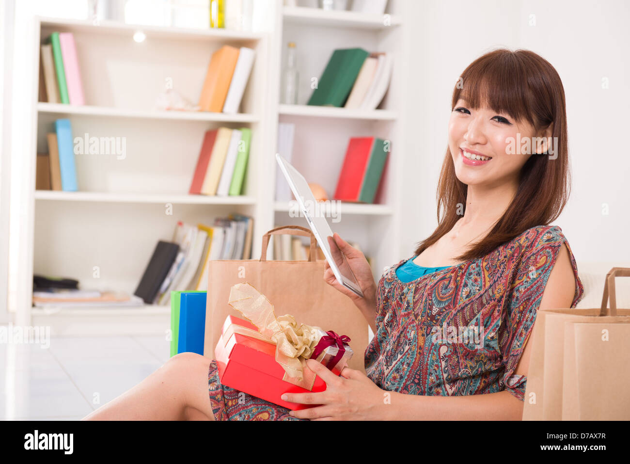 asian Chinese female online shopping with lifestyle background - Stock Image