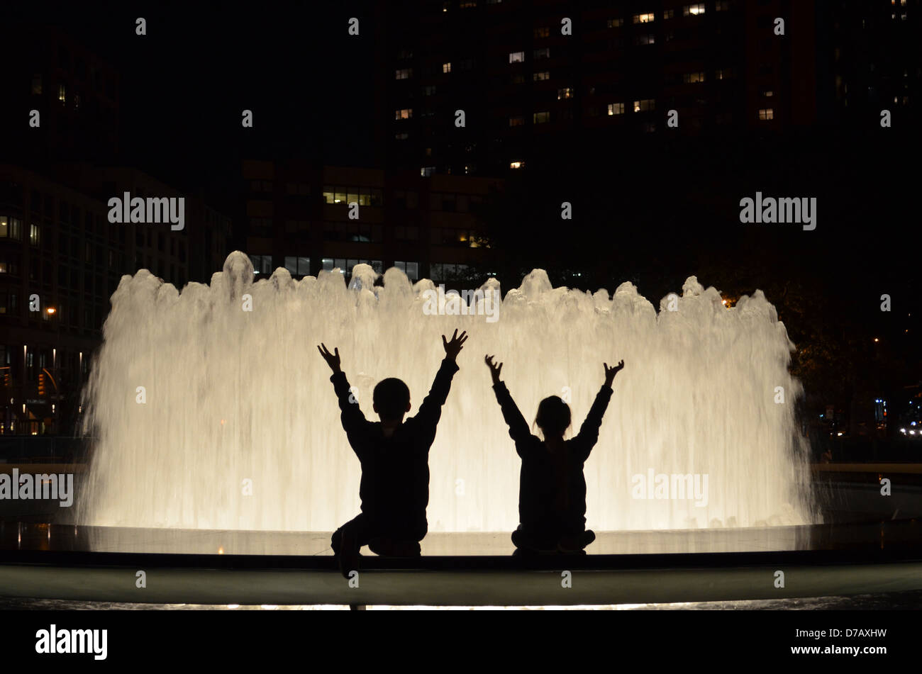 Children's silhouette at the Lincoln Center Fountain - Stock Image