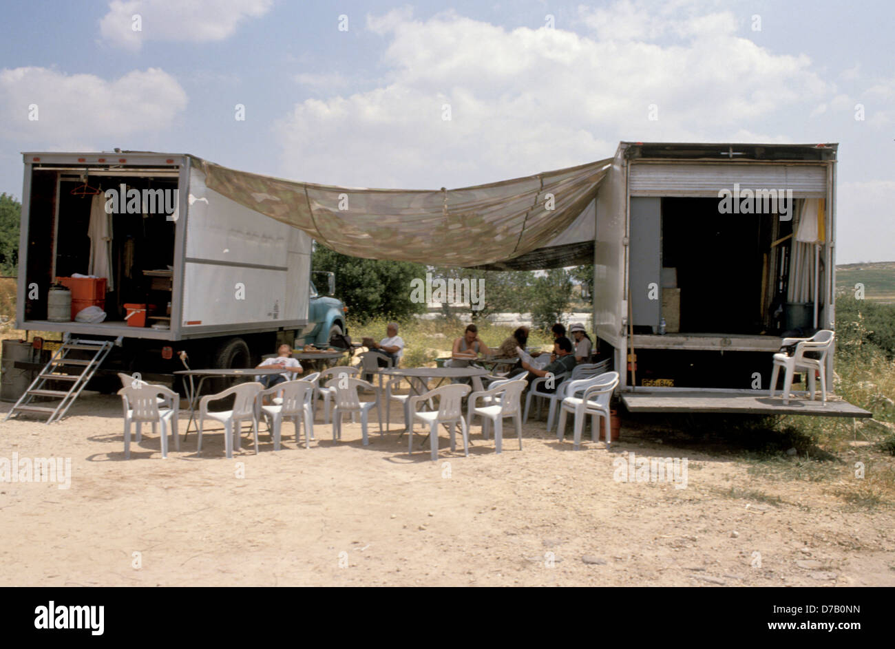 Movie Trucks and Crew on a set - Stock Image