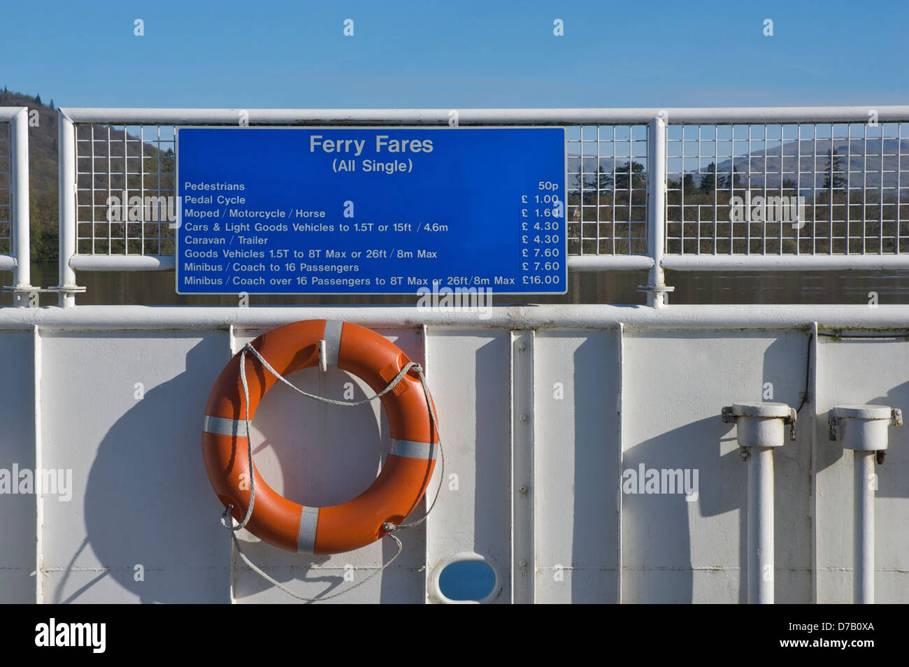 Sign giving price tariff, on the Windermere car ferry, Lake District National Park, Cumbria, England UK - Stock Image