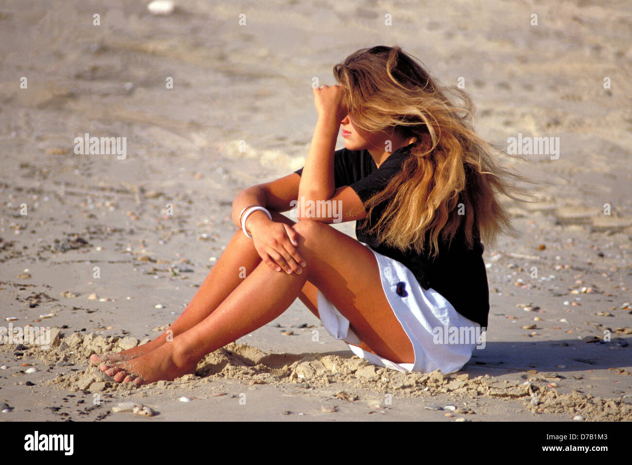 Girl on a beach - Stock Image