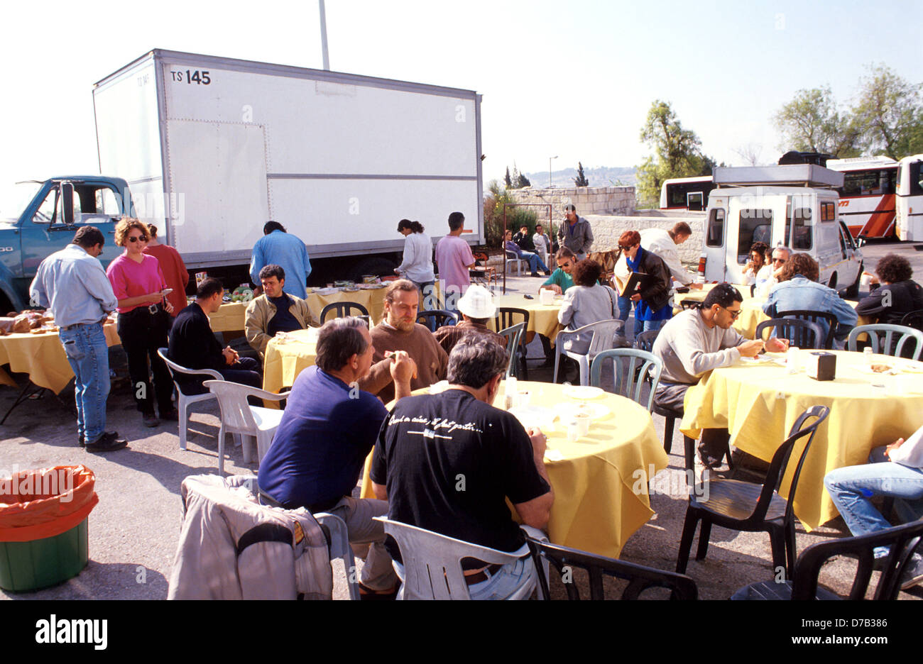 production crew of a movie during a lunch break - Stock Image