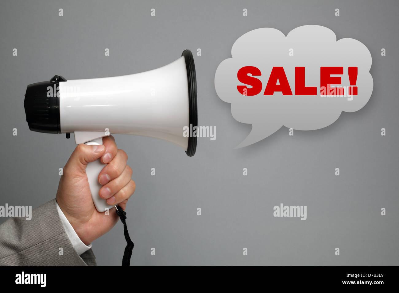 Megaphone shouting sale message - Stock Image