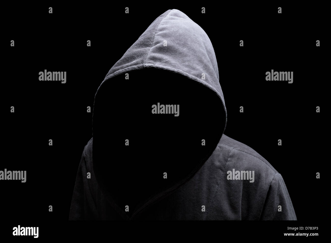 Hooded man in the shadow - Stock Image
