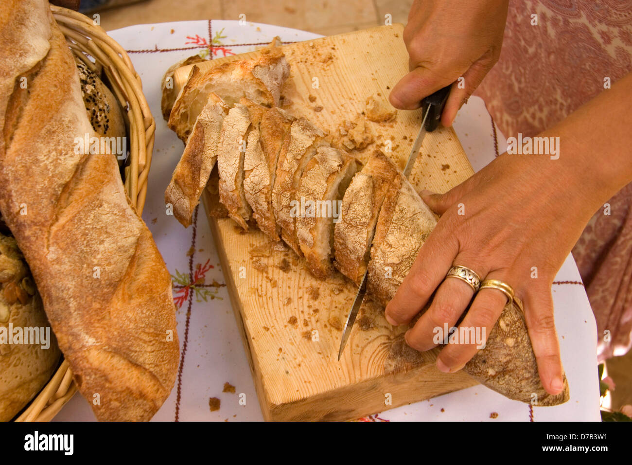slicing a whole wheat home made bread - Stock Image