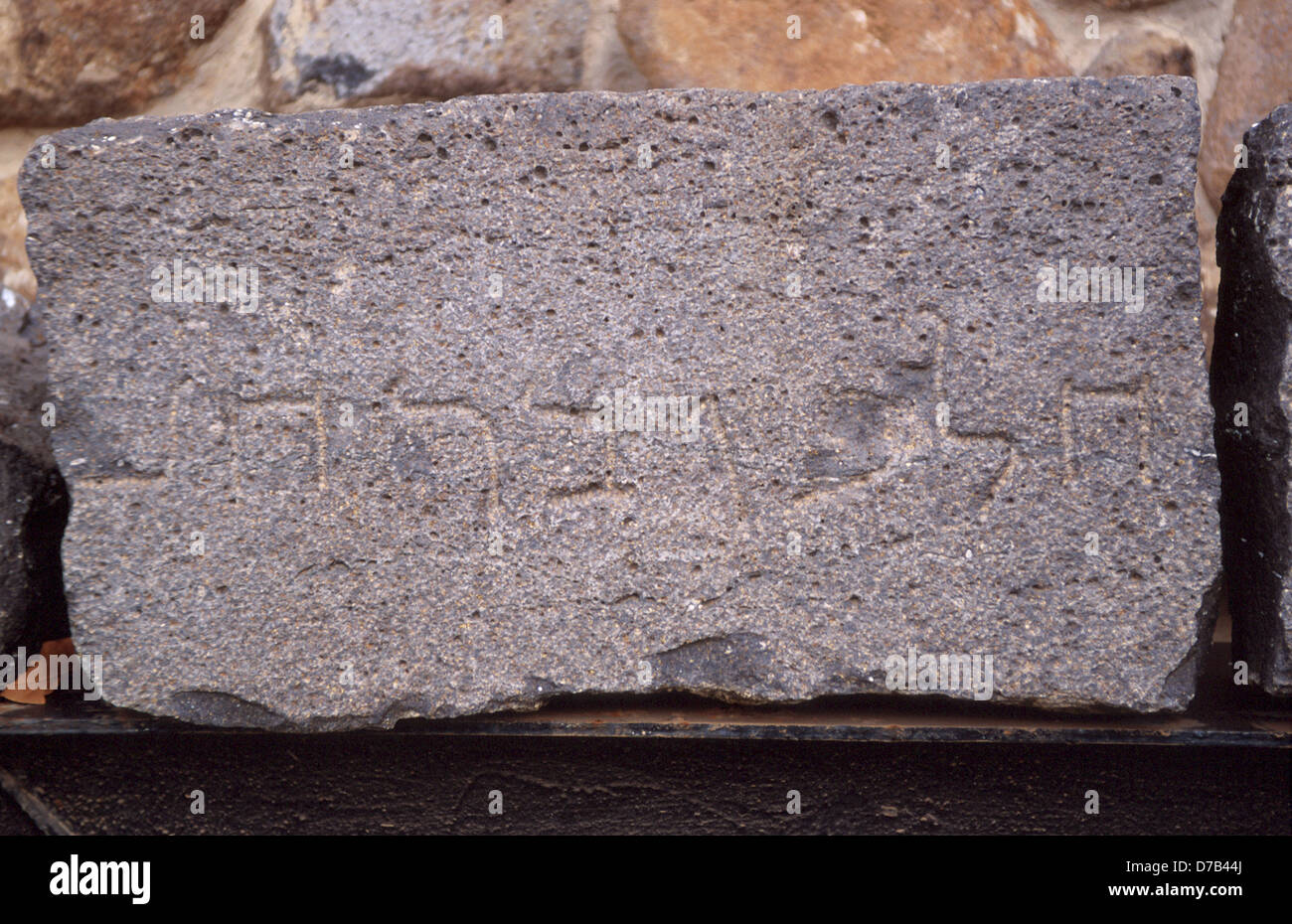 ancient hebrew inscription carved on stone in kazerin - Stock Image