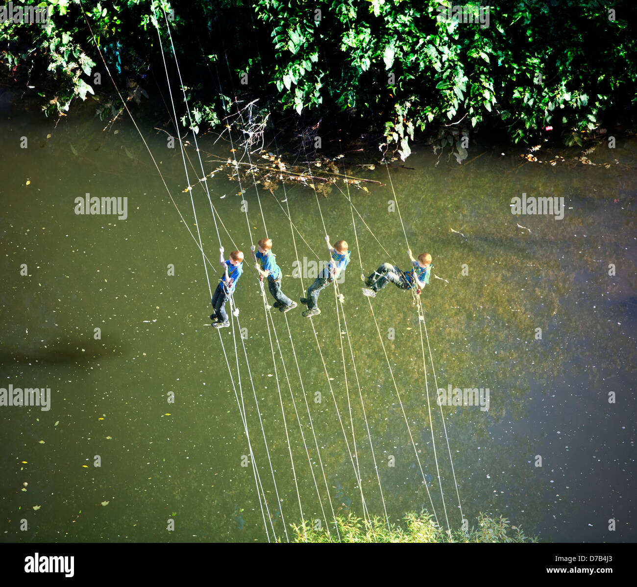 A boy is climbing over river Alzette, Luxembourg, Europe, digital managed - Stock Image