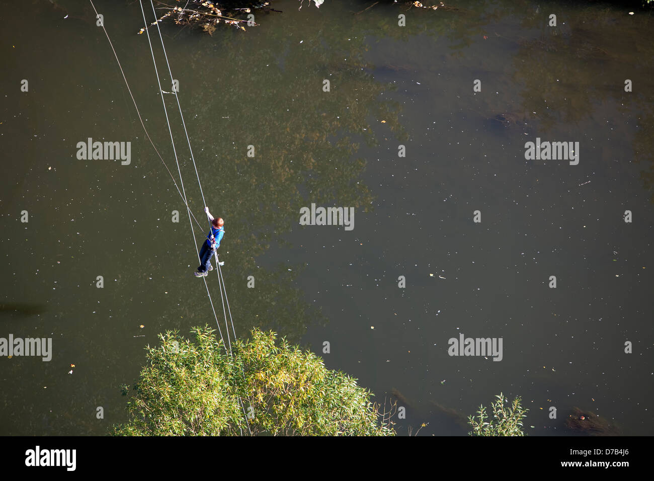 A boy is climbing over river Alzette, Luxembourg, Europe - Stock Image
