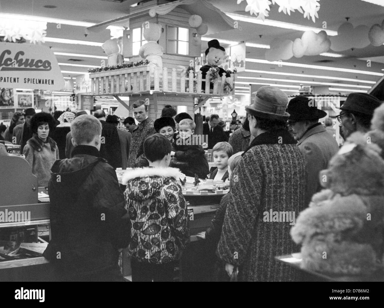 Children and customers crowd in the toy department of a shopping house in Nuremberg in the pre-Christmas time in 1966. Stock Photo