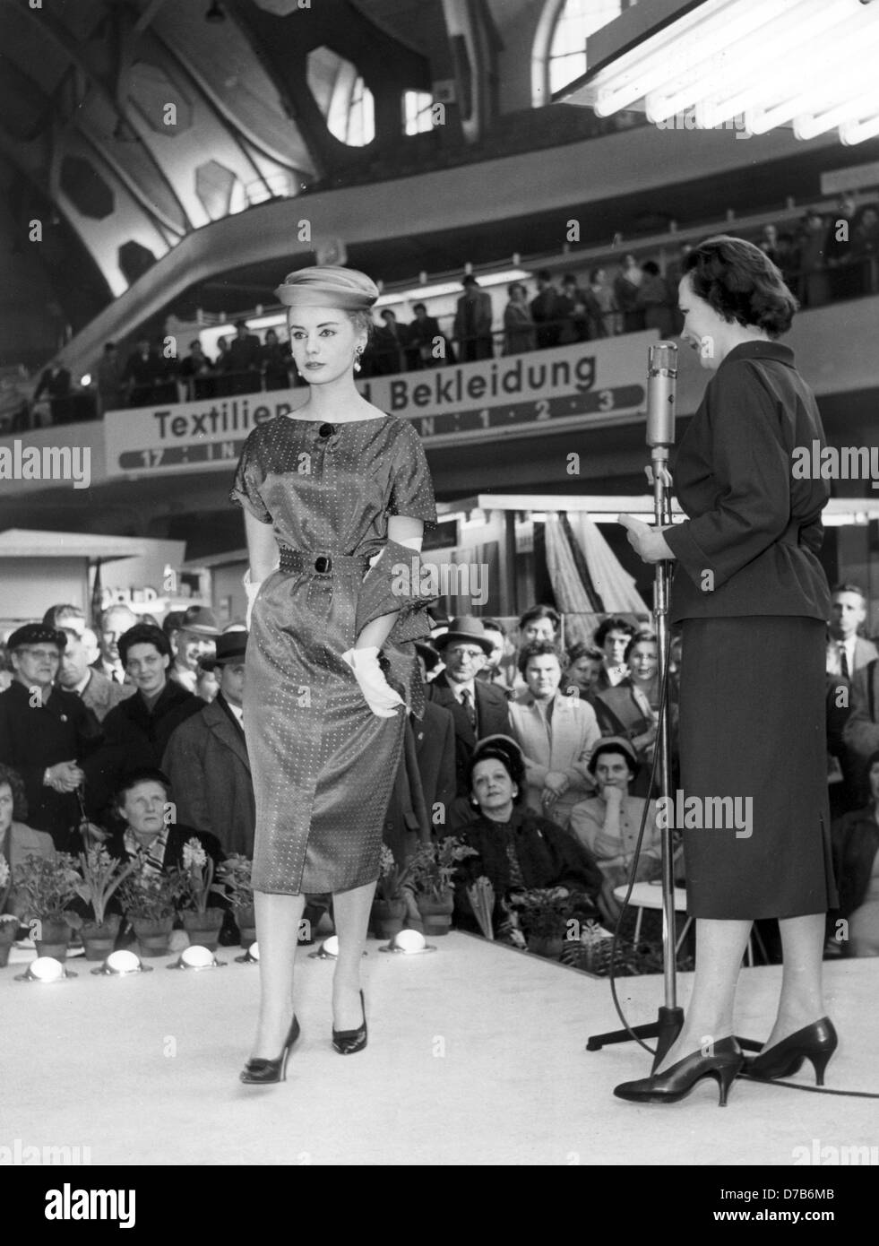 A model presents a dress made of new textiles from Farbwerke Hoechst at a fashion show during the spring fair in Frankfurt am Main on the 11th of March in 1957. Stock Photo