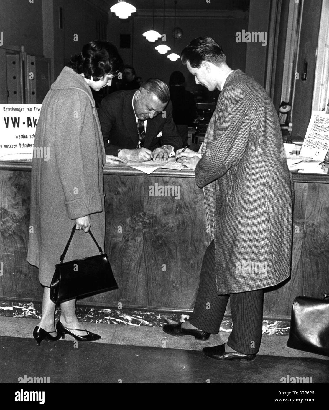 A young couple acquires Volkswagen AG stocks, photographed in January 1961. Stock Photo