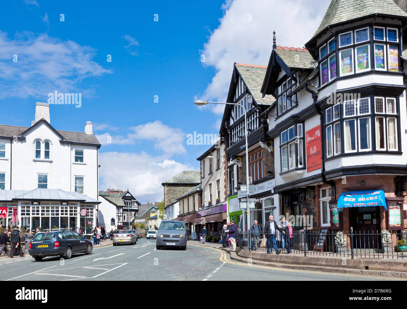Cars driving through the centre of Bowness on windermere Cumbria Lake District England UK GB EU Europe - Stock Image