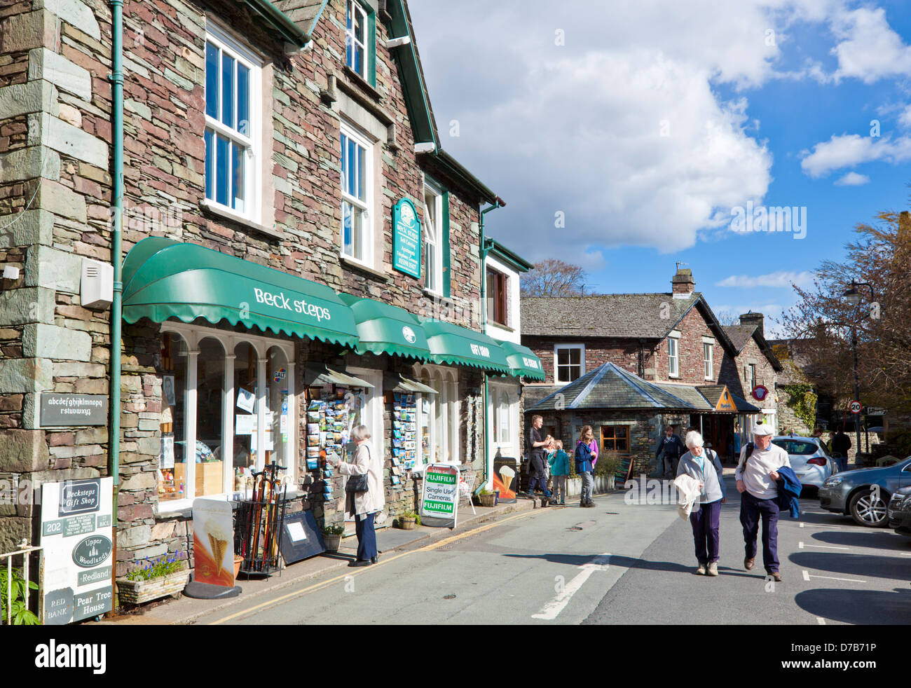 Tourists wandering around Grasmere Village with shops and cafes Cumbria Lake District England UK GB EU Europe - Stock Image