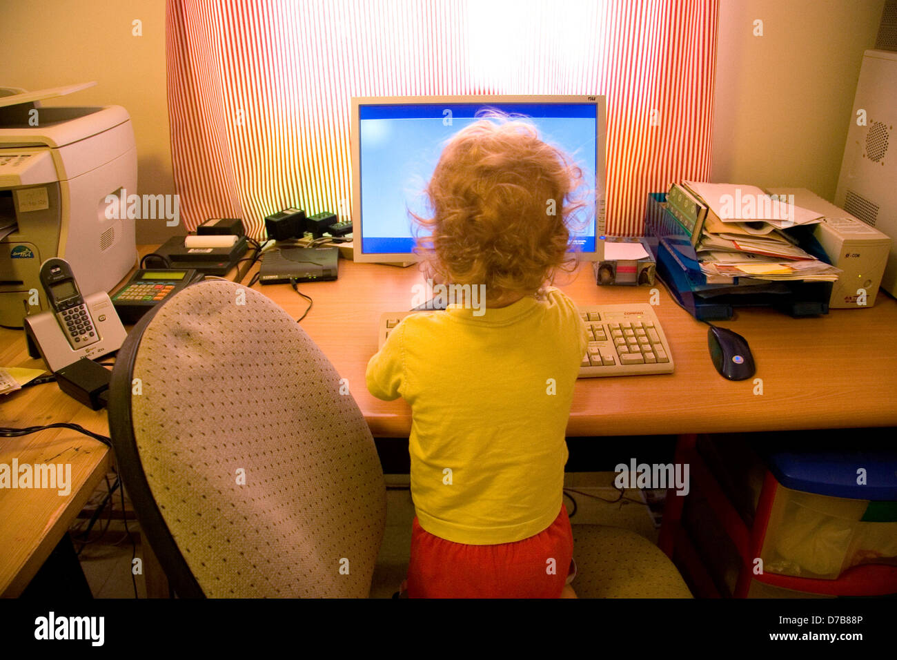Child, age 2, already by the computer - Stock Image