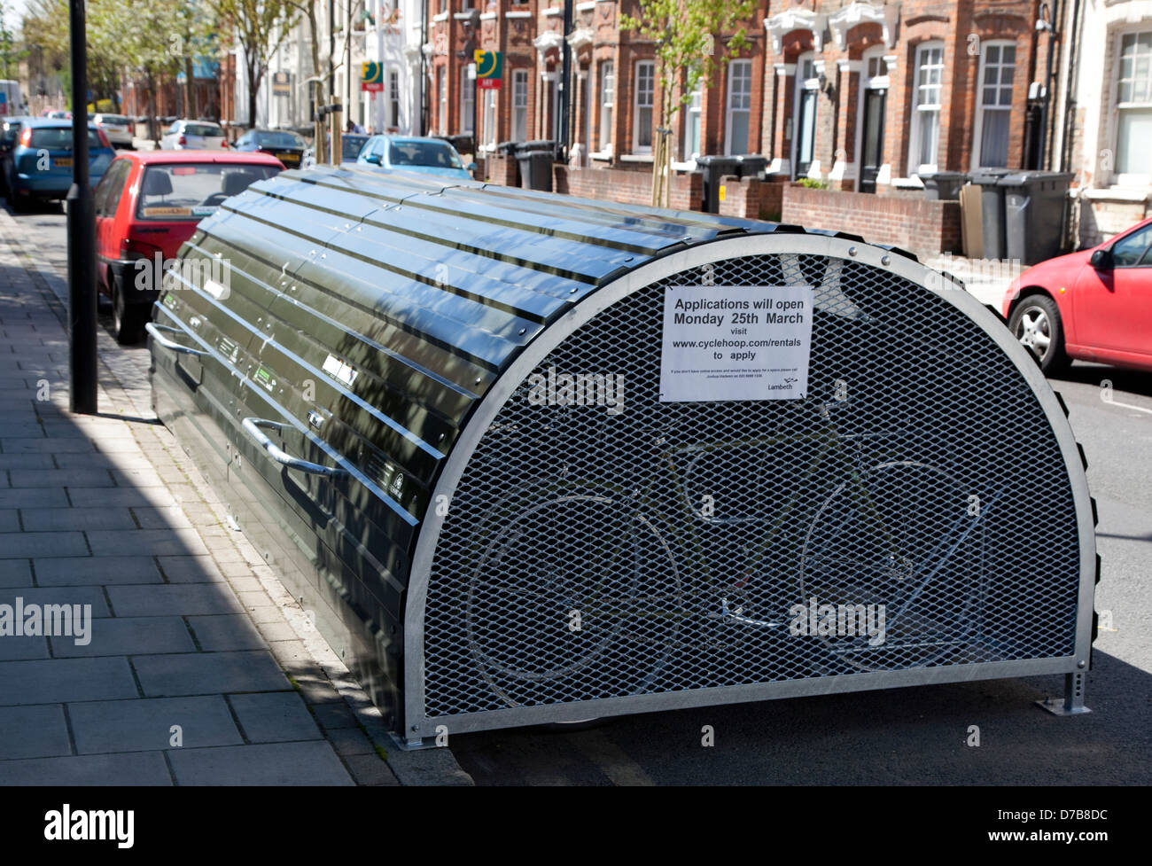 Secure lockable bicycle storage facility in residential street in Stockwell, South London - Stock Image