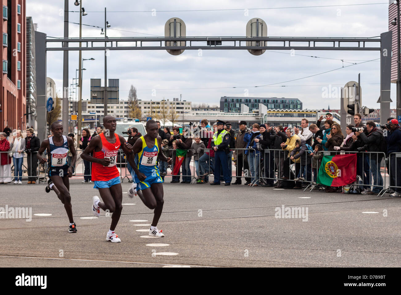Three marathon runners in Rotterdam, The Netherlands - Stock Image