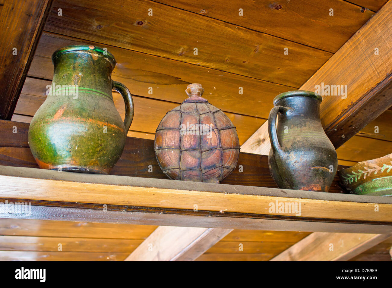 Two pots and copper canteen on wooden background - Stock Image