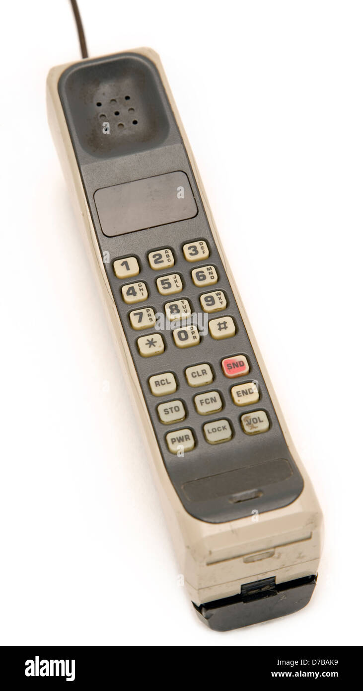 Early 1990's Style Mobile Phone. One of the first models ever made. Isolated on white background. Stock Photo