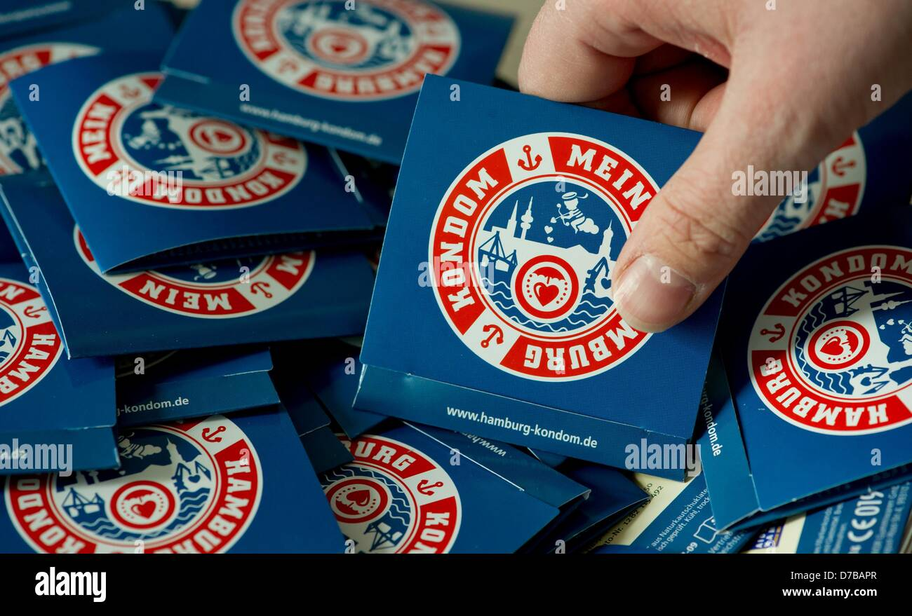Condoms with a logo and the lettering 'My Hamburg Condom' are presented at a press conference of the German - Stock Image