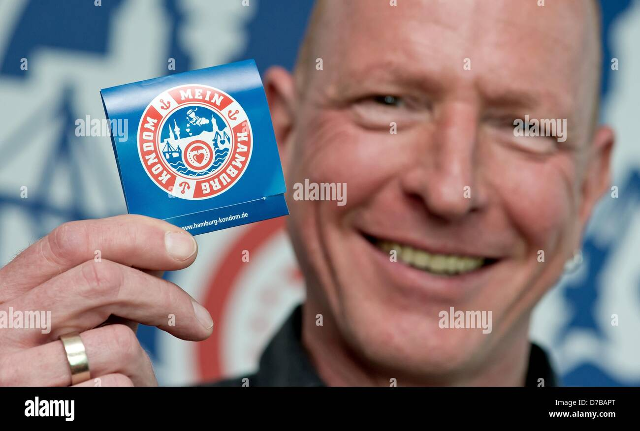 Joerg Korell manager of the German AIDS aid organisation Aids-Hilfe Hamburg e.V. presents a 'Hamburg Condom' - Stock Image