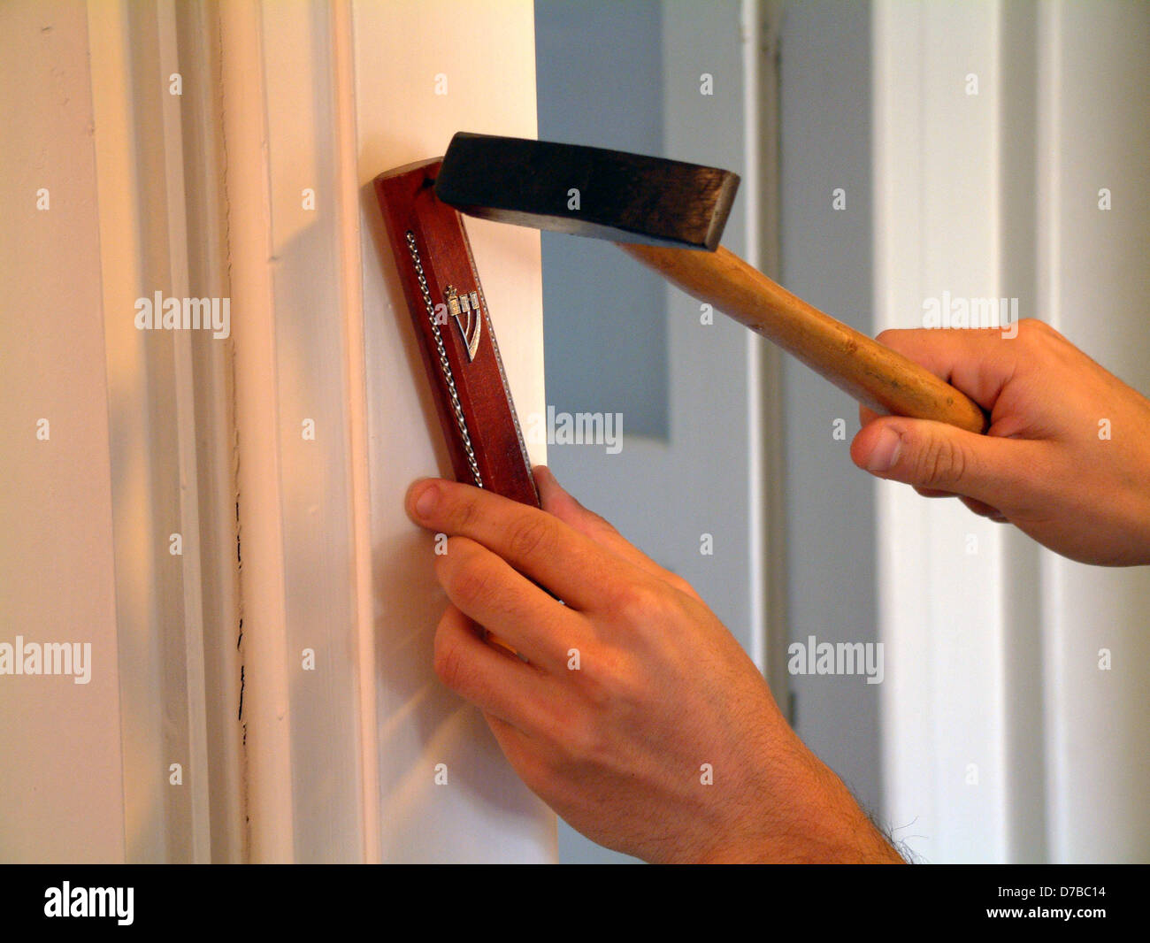 Attaching a mezuzah to a crossbar of a door - Stock Image & Mezuzah Door Stock Photos \u0026 Mezuzah Door Stock Images - Alamy