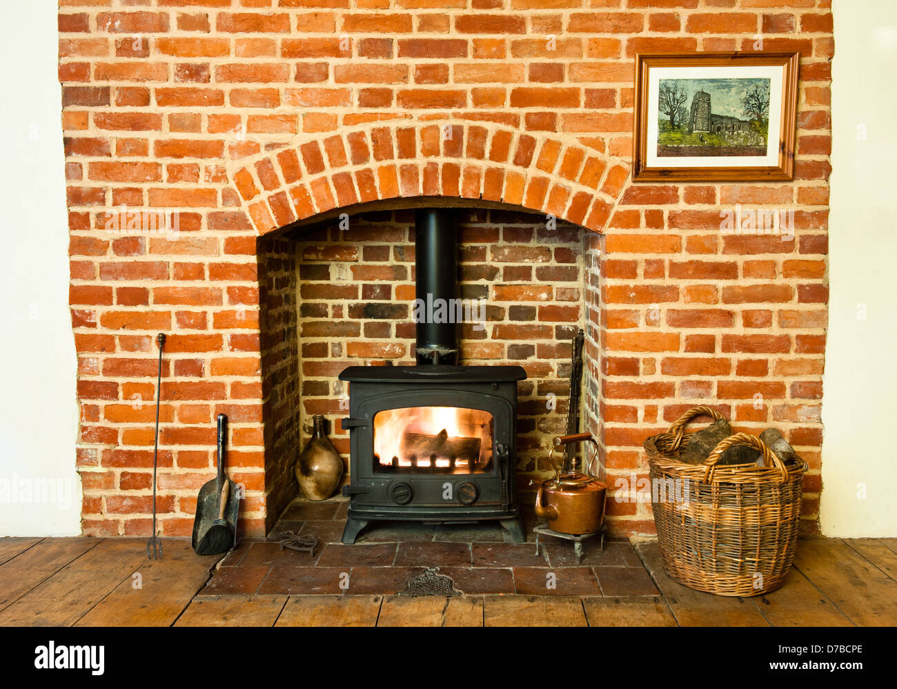 Traditional brickwork stove and fireplace. - Stock Image