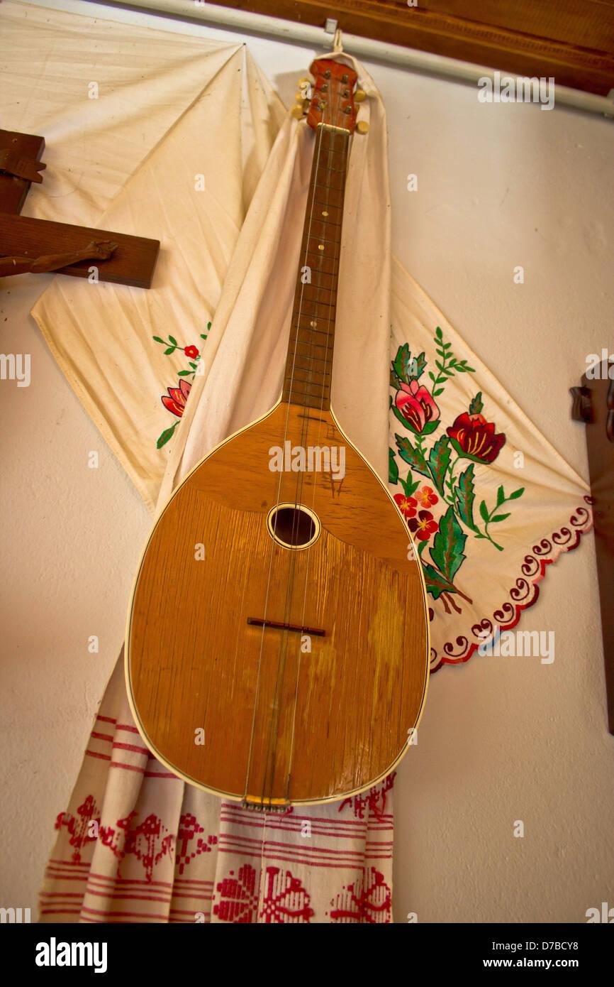 Tamburica (tambourica)- Croatian traditional music instrument on the wall - Stock Image